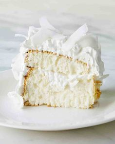 Coconut Cloud Cake  This cake is delicious!  It is not difficult to make and is best with freshly grated coconut as shown in pic. :)