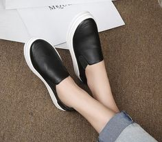 - Stylish black slip-on casual shoes - Available in black leather or black suede - Rubber white sole