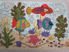 Melissa Shirley Designs Tropical Fish needlepoint canvas.  Stitch Guide by Fireside Stitchery.  Stitched by Cheryl Timko
