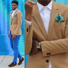 Tan jacket, blue trousers. Small touches with the socks and pocket square