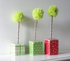 Christmas Bud Vases, Set of Three, Green Red and White, with Pom Pom Flowers. $24.00, via Etsy.
