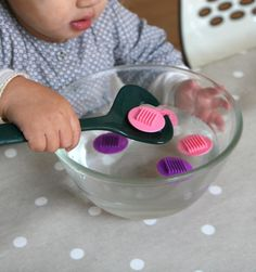 Spoon fishing to work concentration, eye-hand coordination and fine motor skills. Montessori Baby, Montessori Education, Montessori Activities, Infant Activities, Activities For Kids, Baby Games, Games For Kids, Diy For Kids, Practical Life