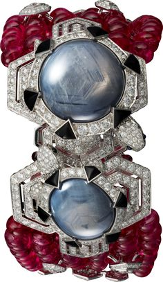 CARTIER. Bracelet/Brooch - White gold, two round-shaped and oval-shaped cabochon-cut grey blue star sapphires from Burma totalling 71.35 carats, spinel beads, cabochon-cut sapphires, onyx, brilliant-cut diamonds. The small turtle can be worn as a brooch. #Cartier #CartierMagicien #HauteJoaillerie #FineJewelry #Sapphire #Spinel #Diamond #Onyx
