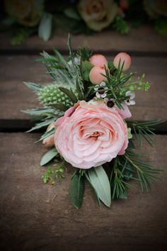Bombastic Spray Rose buttonhole with Eryngium and Hypericum Berries