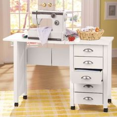 """BWad board sewing desk Our Sewing Desk can be rolled from room to room to closet. Handy drop-leaf table on casters gives you a sturdy work surface that holds up to 200 lbs. Vinyl laminate with attractive beadboard sides. 44 3/4"""" l x 29 1/2"""" h x 18"""" d with drop leaf raised; folds to 19"""" l x 18"""" d. Assembly required."""