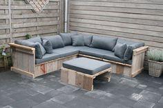 canapé d'angle fabriqué en palettes de bois - une solution DIY abordable pour la terrasse