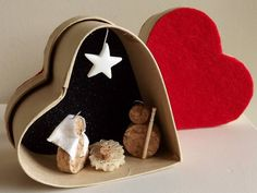 Nativity in a heart box Corks recycled. Nativity Crafts, Christmas Nativity, Noel Christmas, Christmas Projects, Christmas 2019, Holiday Crafts, Christmas Ornaments, Nativity Sets, Crafts For Kids