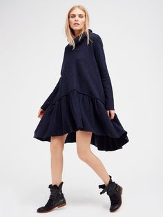 Ruffle Up Tunic | Luxe merino wool tunic features a dropwaist silhouette and an…