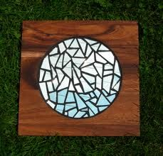 broken mirror mosaic: I like the contrast of the glass and color of wood.