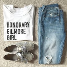 Oy with the poodles already! Anyone else obsessed with Gilmore Girls? Wear your inner fan girl proudly in this super soft tee! White with black lettering. Slimmer fit crew neck. Order up one size for