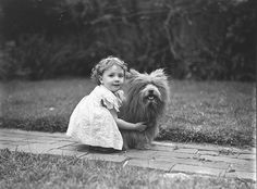 Study of a small girl with a prize Scottish terrier dog, c. 1935 / by Sam Hood.