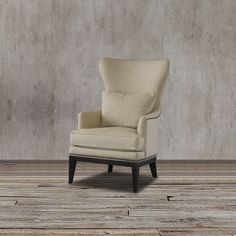 Upgrade your living space with this wingback arm chair that features a deluxe seat cushion, kidney pillow, brass nailhead trim, natural colored upholstery and aged black finish to create that traditional appeal.