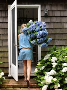 It's not English Cottage but it is close enough! Love the blue hydrangeas!  House tour: the idyllic Hamptons cottage of two antique dealers: