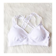 • Racerback Bralette • Please comment below what color(s) you would like. Super cute, stretchy and comfy racerback. Perfect to wear with an open back top. Removable pads & elasticized trim. 88% nylon, 12% spandex. One size fits most.  COLORS AVAILABLE: White Jennifer's Chic Boutique Accessories