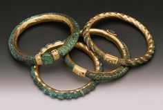 Jewelry Artist Ronda Coryell created these amazing bracelets from bronze dating from 500 BC. They are hammered and laser welded and have 22k gold and granulated accents.
