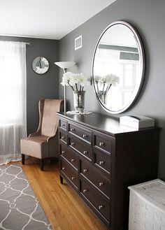 Dark wood built in, light wood floors, grey walls :)