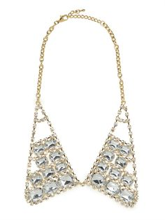 The collar silhouette is one of our favorite statement necklaces by far.  We decked this one out in crystals of varying sizes for a look that's intricate yet glam and the perfect topper for seemingly simple fare.  This is part of BaubleBar's 2nd Anniversary Collection