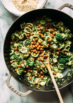 Orecchiette with broccoli rabe and chive pesto is a fresh and flavourful meal. Naturally nut-free and vegan, this bright green pasta is great for Spring.
