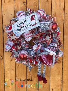 This adorable Christmas Gnome wreath sits on red and white furry Deco Mesh and sports a cute gnome doll sitting on the side of the wreath, the gnome looks nordic as does the look of the whole wreath. This gnome wreath is covered in beautiful ribbons of grey and white snowflakes with a furry border, a red and gray swirl pattern, a fun Christmas tree plaid ribbon, and finally a grey, white and red nordic looking ribbon with reindeer and snowflakes. This wreath also includes a cute gnome sign.
