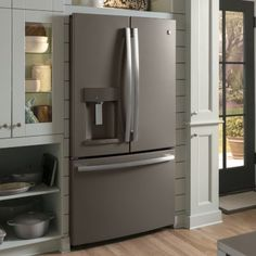 Kitchen Featuring Slate GE French Door Refrigerator With Bottom Freezer.