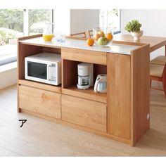 キッチンカウンターで幅が狭いものがいいですね。  カウンターは背面処理がされているので、テーブル側から見た時にきれいなのです。  今のラックは操作面がキッチンの反対側に向いていて、とても使いにくそうですし、何よりもテーブル側から電気製品の後ろ側が丸見えで見苦しいです。