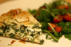 Jamie Oliver's Spinach and Feta Phyllo Pie from his book 'Meals in Minutes'.  Delish and both side salads (Tomato and Cucumber) are excellent as well!