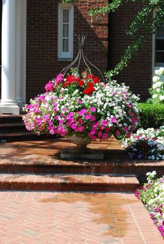 Create in wood fountain at front porch with annuals in pots