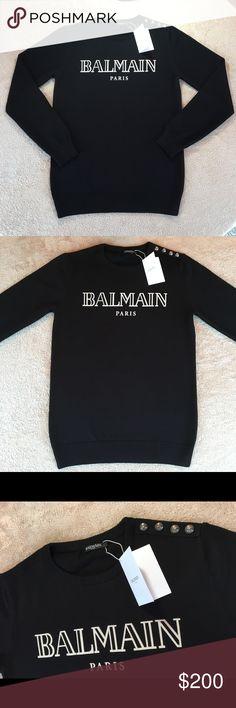 Balmain Sweater Black 100% cotton sweater from Balmain.  *Silver embossed buttons along the shoulder.  *White Balmain Logo Balmain Sweaters Crewneck