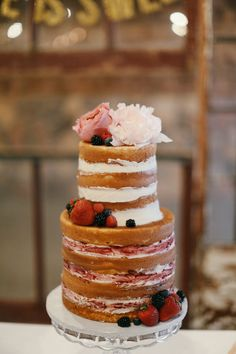 Naked Cake with fresh fruit and floral- Photo By Feather & Twine Photography