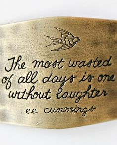 This sentiment is made to attach to either the wide L leather cuff or two of the braided bracelets. It features the quote 'The most wasted of all days is one without laughter. -e.e. cummings' with the image of a flying sparrow. Each piece of the L Collection is handcrafted locally in Tennessee.