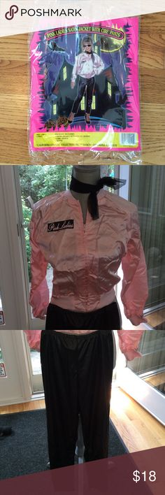 """Pink Ladies Girl's Costume Adorable costume worn once with plenty of life left. Black pants include elastic waist band. Pants measure approximately 34"""" from waist to bottom of leg. Inseam measures approximately 23"""". Pink zippered jacket includes elastic waistband and wrists. Jacket is 100% acetate, pants are 100% polyester. Jacket is dry clean only; pants are machine wash. Costume includes all of its original contents: satin jacket with front zipper, cire' pants, scarf. California Costume…"""