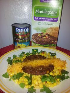 MorningStar Farms Spicy Black Bean Veggie Burger topped with sharp cheddar cheese!  Served over Corn with peppers and fresh cilantro! Mmmm! Good:)) #GotItFree