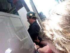 I guess Harry fell out of the tour bus and security had to catch him.. LOL.