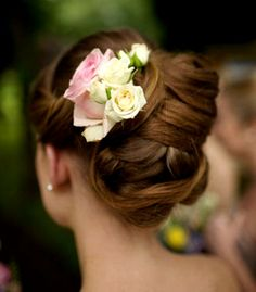 Bride's beautiful braided chignon bun bridal hair ideas Toni Kami Wedding Hairstyles ♥ ❶ with roses wedding hairstyle