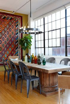 a collection of ideas for decorating two story walls... rug hanging in dining. Check out that immense table!