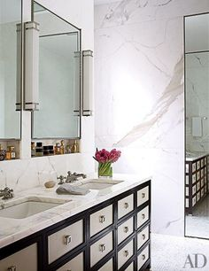 The master bath of a New York City apartment designed by Peter Marino is clad in Calacatta gold marble | archdigest.com
