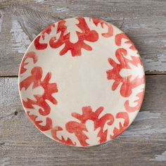 """Guided by an ethos of environmental and cultural awareness, each of these intricately painted side plates is shaped and glazed by hand in a South African design collective.- Ceramic- Hand-thrown, size, shape, and print may vary slightly- Dishwasher and microwave safe- Handmade in South AfricaApproximately 0.75""""H, 9"""" diameter"""