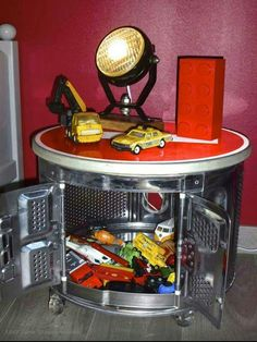 A washing machine drum into a table with storage and wheels !!!