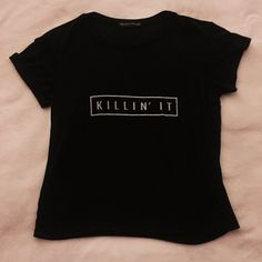 Killin it brandy Melville tee Perfect condition very size. It's cropped and very flattering Brandy Melville Tops Crop Tops