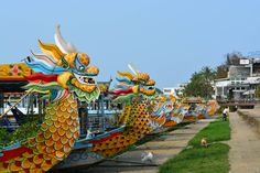 Your Dragon awaits for a cruise down the perfume river in Hue during your Vietnam tour. Vietnam Holidays, Vietnam Tours, Hoi An, Summer Travel, Tree Branches, Hue, Cruise, Art Pieces, Fair Grounds
