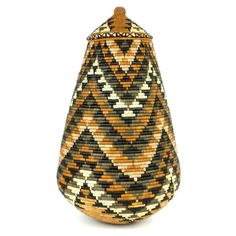 This basket is handwoven in South Africa Baskets like this are often give as a wedding gift. This beauty comes with a tight-fitting lid is adorned with the traditional Zulu design in natural dyes. 22""