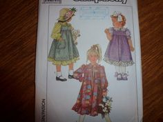 Vintage pattern by Simplicity. Childs dress and Jumper size 3. Dress and jumper are gathered to self-lined buttoned bodice above waistline.