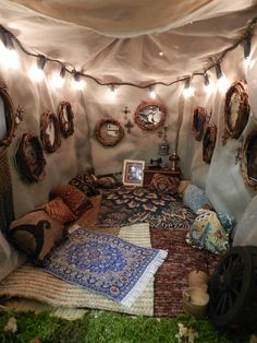 whoa, this is cool. all the patterns. and the wooden wreath circular mirrors...umm sister!!!??? Lets turn that shit in the backyard into this,  this spring???