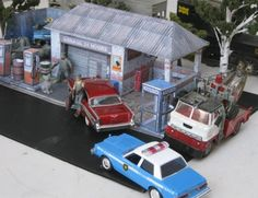 The Generic Garage Paper Model - Assembled by Robert Quebec        My friend, the designer and modeler Robert Quebec built the Generic Garage. He make a nice diorama and send me some photos. I always say it's a honor to me see one of my models assembled by a friend modeler. i really apreciate this! Thanks, Robert! Very kind of you send me these nice photos! Greetings from Brazil!