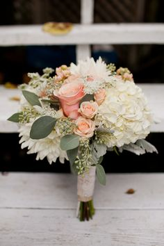 large roses and small roses, hydrangea, queen ann's lace, seeded eucalyptus, dahlia's, etc.