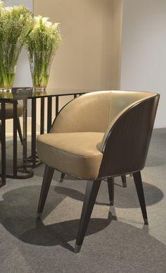 New Kos dining chair in Ebony veneer, leather upholstered and black nickel caps