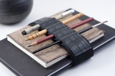 What an awesome idea! Pencil case alternative / Adjustable Bandolier / Reclaimed Rubber. $25.95, via Etsy.