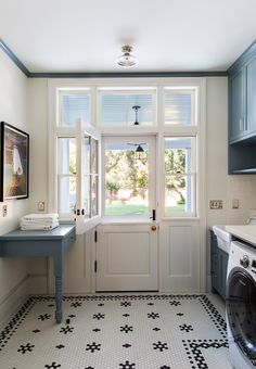 Dutch door laundry room with classic vintage inspired penny tiles. Tim Barber house tour