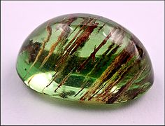 Tsavorite is a highly prized gem variety of grossular garnet. It was first discovered by Campbell Bridges in 1967 near Kenya's Tsavo National Park. This region on the Kenya-Tanzania border remains the only source of gem tsavorite. The most valuable tsavorites are an intense green to blue-green and can sometimes be confused with emerald; a yellowish overtone is less desirable.