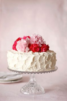 A White Cake Topped with Fresh Carnations makes a perfect edible bouquet for mom